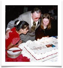 Emily & Amy Ramsey blowing candles with Ed