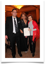 Awee Abayari, VP of Tri Media and her son, C.J. Abayari Puente presenting Raqui with a certificate