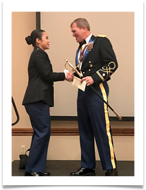 LTC Thomas Brede presents the Col. Ed Ramsey Scholarship Endowment Award to Cadet Kelly Vu