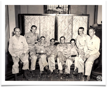 Manila 1945, Ed is 3rd from left, Maj. John Boone is 2nd from right, center is President Manuel Roxas, 1st President of Philippines