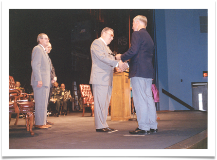 Ed is presented with the OMA Hall of Fame Saber, 1994