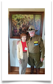 Jeffrey L. Maahs and Raqui in front of the painting of the Last Cavalry Charge in the Museum