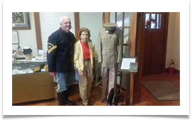Col. Sam Young, Editor, U.S. Cavalry Journal with Raqui beside Ed's uniform and boots at the U.S. Cavalry Museum