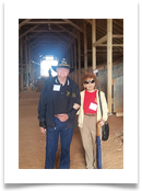 Raqui and Col. Bill Tempero touring the horse stables as they undergo reconstruction