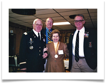 Col. Sam Young, Maj. Bob Seals and Trooper Tim Riley with Raqui