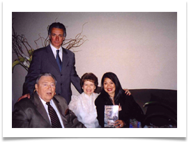 Jacqui Lingad-Ricci holding Ed's book with husband, John Ricci standing behind Ed & Raquel on May 28th, 2005 during reunion