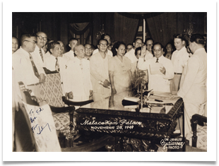 Ed with Juan Benitez being sworn in as Philippine Veterans Board Chmn by Pres Elpido Quirino, Malacanang Palace 1949