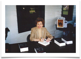 Raqui signing Ed's books at the Headquarters of the U.S. Cavalry Association
