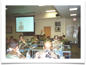 Col. Ramsey giving lecture to Green Berets
