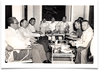 "Col. Ed Ramsey with some of his ""boys"" at the welcome party at the residence of Col. Amado N. Bautista, QC, Philippines, 24 July 1960"